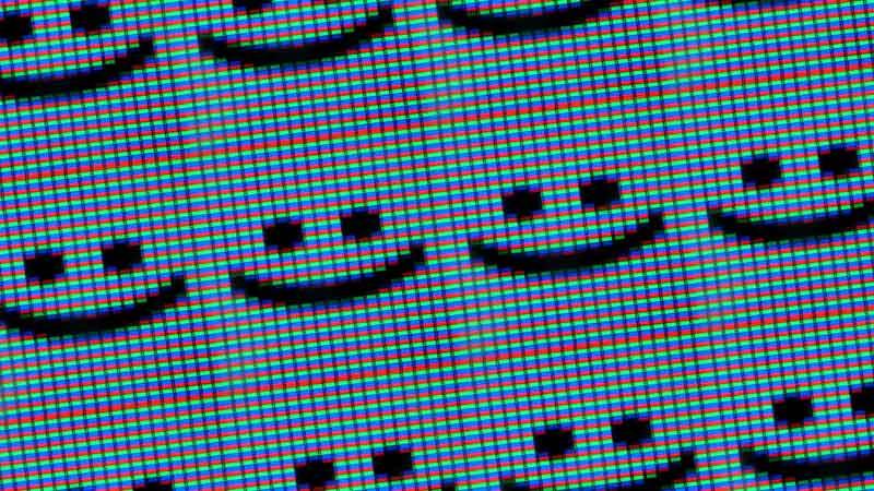imagen pixelada de emojis sonrientes en una pantalla